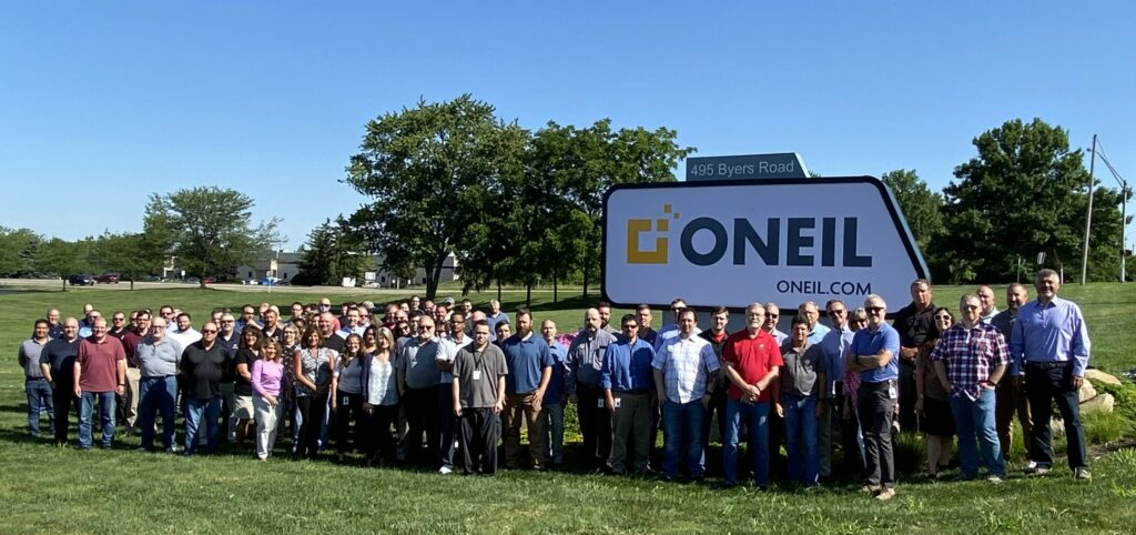 The ONEAL Team in front of new sign